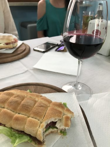 A staple lunch, foccacia and a glass of red