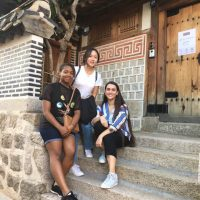 Touristy pictures to be expected! Left to right, me, our buddy Gayoun, and Rebecca outside a traditional style house in Bukchon Hanok Village.